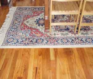 Area rug on re-finished oak floor