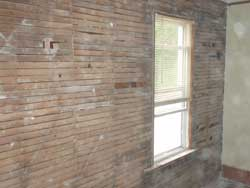 lath behind the plaster walls